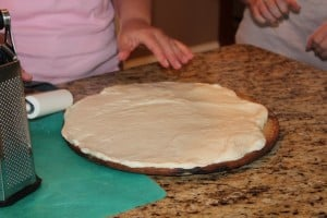 prepping the pizza dough