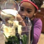 adding milk to the shamrock shake recipe