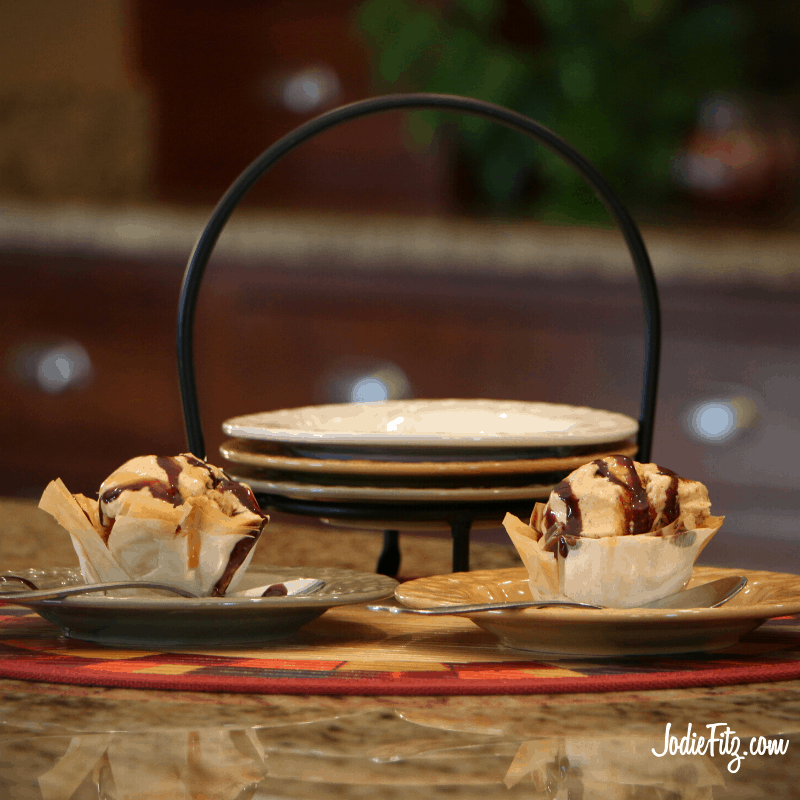 Pumpkin Ice Cream served in homemade edible phyllo dough bowls with caramel and chocolate sauce drizzled on top