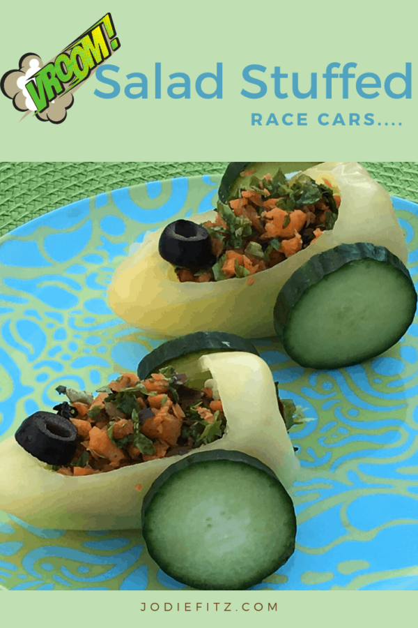 Salad Race cars made of a a pepper car body, cucumber wheels, stuffed with salad and an olive steering wheel