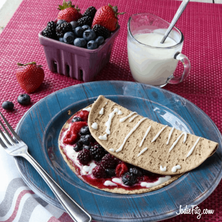 Berry Breakfast Taco made with wholegrain flatbread, mixed frozen berries and a sweetened cream cheese baked with a yogurt gaze on top.