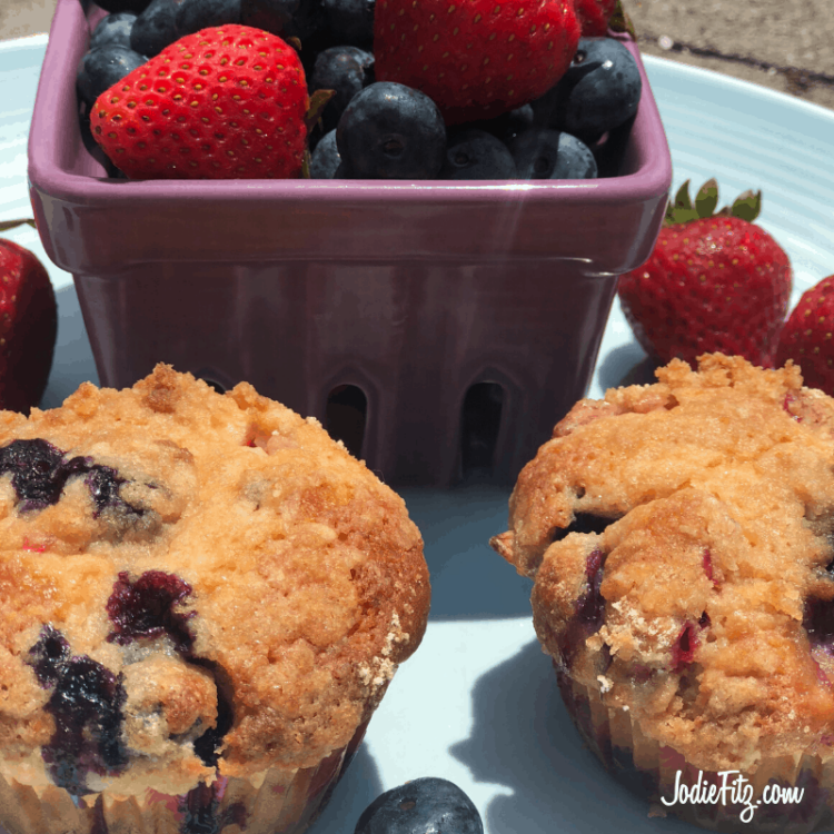 Homemade Berry Crumb Muffin Recipe baked with fresh berries in the batter and crumb topping on top.