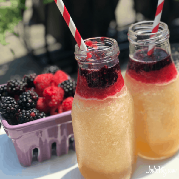 Frozen Berry Lemonade made with fresh ingredients topped with a layer of fresh blackberry puree and a layer of fresh raspberry puree to create a red, white and blue affect.