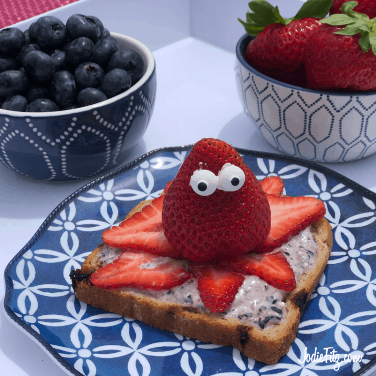 Strawberries sliced and placed to form the tentacles of an octopus with one whole strawberry sitting on top as the body with candy eyes on toast for breakfast fun.