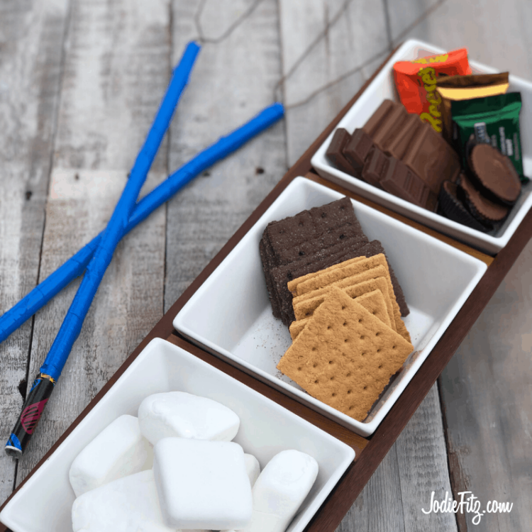 DIY Marshmallow Roasting Sticks made out of wire hangers and electrical tape. Perfect for s'more making.