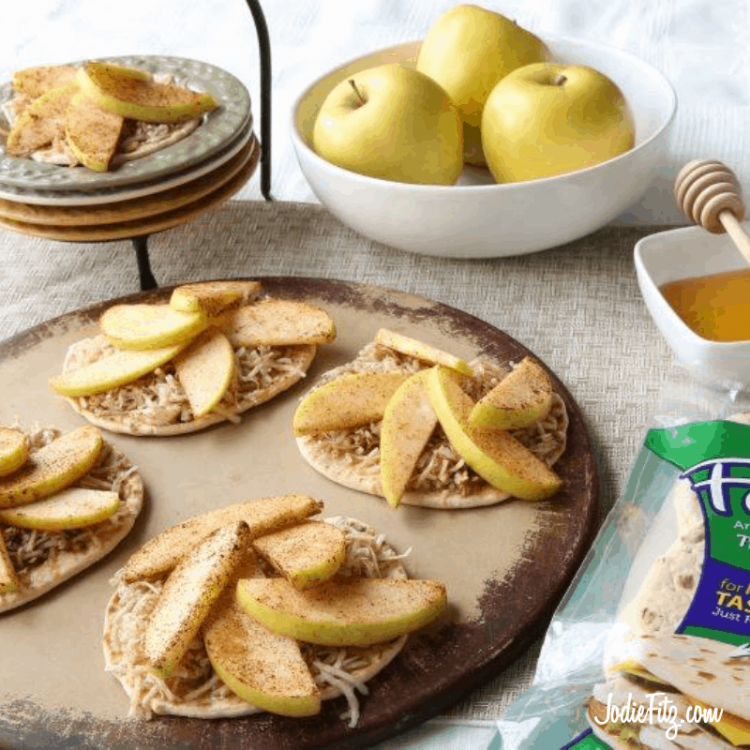 Baked Apple Snacks made with honey, cinnamon, cheese and whole grains in the shape of a pinwheel.