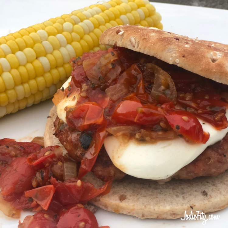 Italian flavored turkey burger topped with fresh sliced mozzarella and homemade tomato chutney on a 100 calorie wholegrain round served with a side of sweet corn.