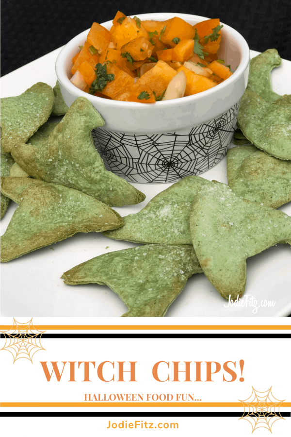 Homemade spinach chips in the shape of witches hat served with a homemade orange salsa with a heirloom tomato and orange bell pepper base served in a Halloween dish