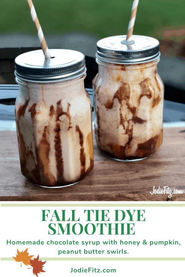 Tie Dye Smoothie made with a chocolate and pumpkin orange swirl affect served in glass mason jars with striped paper straws