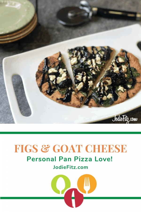 A personal pan pizza made with fig, honey goat cheese, spinach on a whole grain naan bread topped with balsamic glaze
