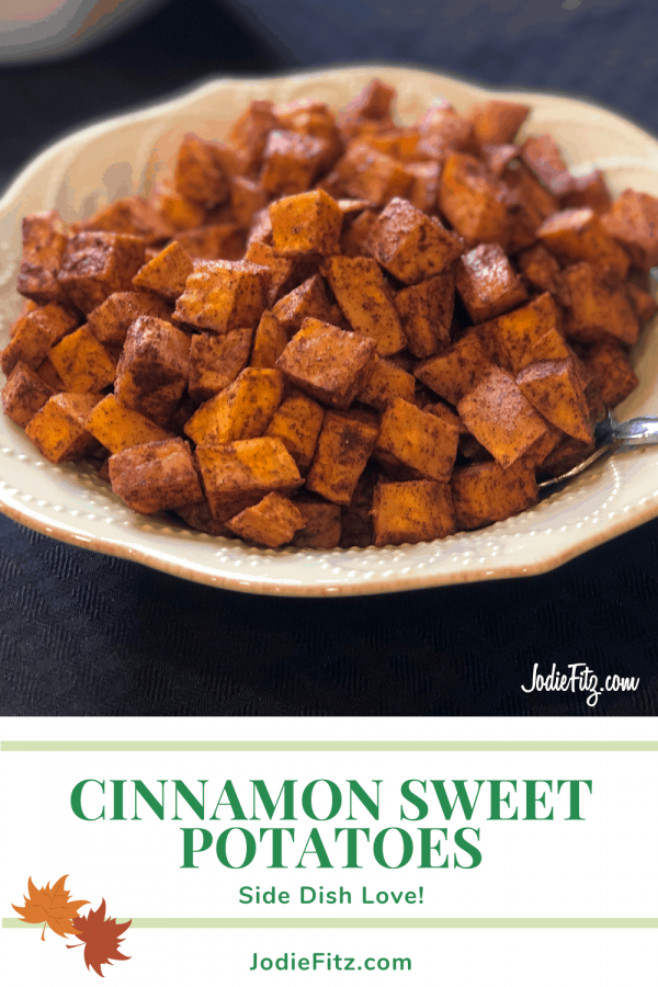 Diced sweet potatoes coated with cinnamon and other spiced, cooked and served in a scalloped bowl