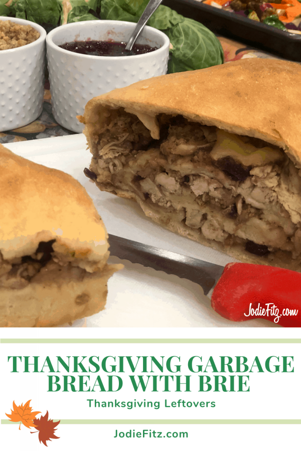 A garbage bread rolled with brie cheese, leftover turkey, cranberry sauce and stuffing baked and sliced, ready to be served