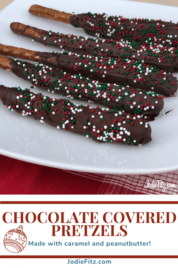 Chocolate covered pretzels with caramel with red, white and green sprinkles on them on a white dish ready to serve
