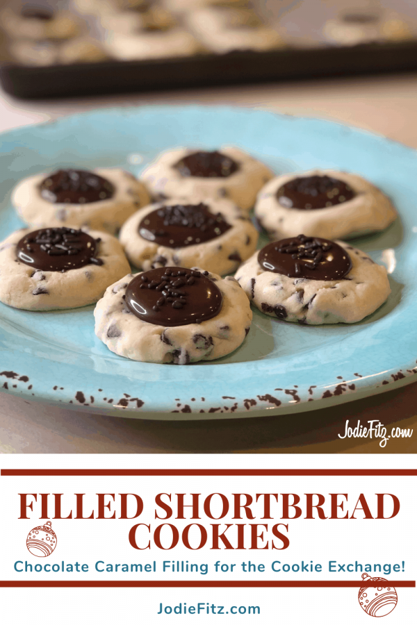 Chocolate filled Shortbread Cookies with a chocolate caramel filling and chocolate sprinkles on top placed on a blue serving plate