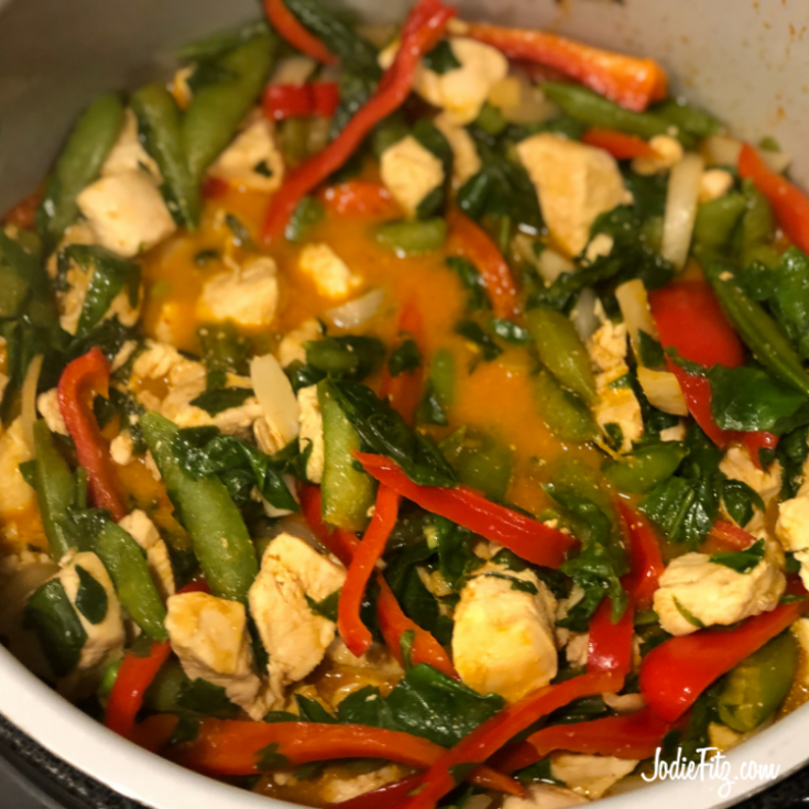 Cooked chicken, sugar snap peas, red bell purple, spinach in curry sauce in an Instant Pot