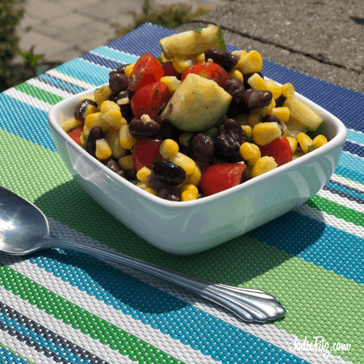 Corn Salad made with corn, black beans, tomatoes, cucumber, cilantro and homemade dressing