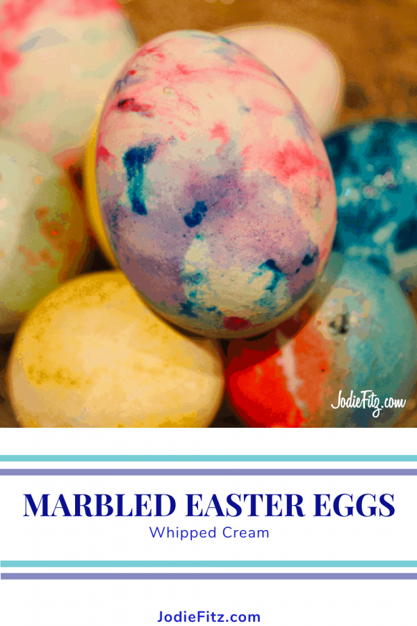 A few marbled easter eggs sitting on a table