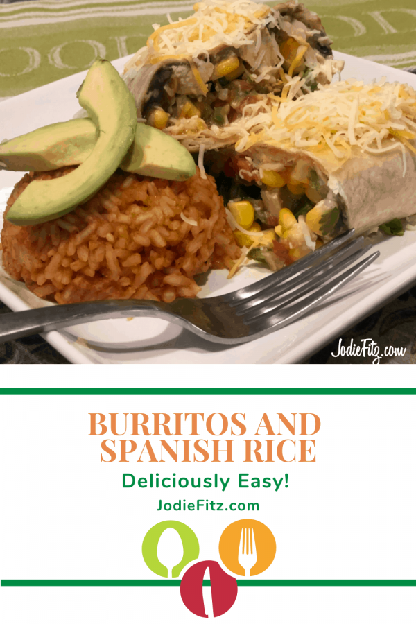 Mission burrito cut in half, topped with cheese and filled with chicken, corn salsa, salsa, black beans and cheese served with a scoop of Spanish Rice and fresh avocado slices