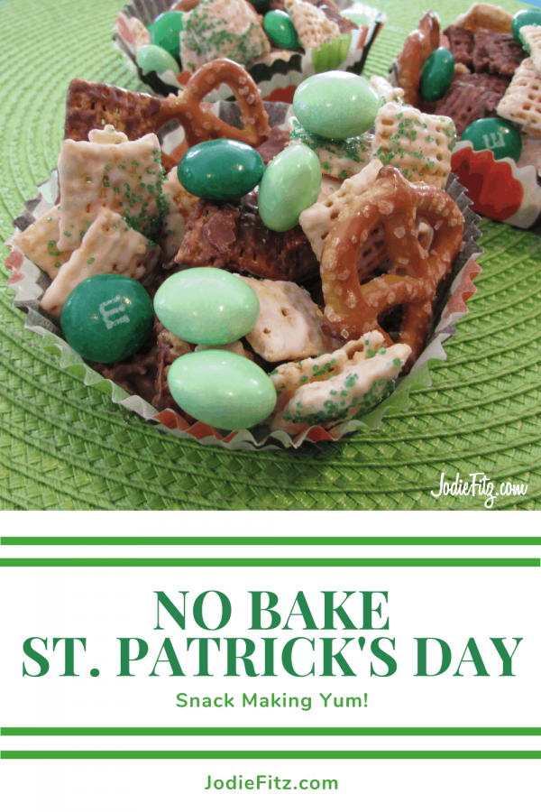 Two St Patrick's Day Treats filled with pretzels, M&Ms, yogurt covered Chex Mix, and chocolate served in cupcake liners
