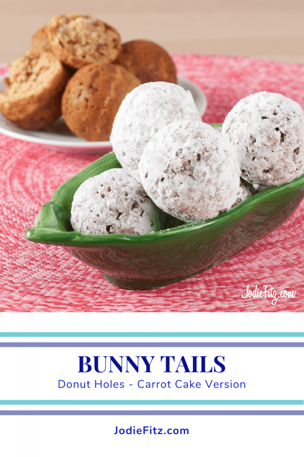 Green bowl with powdered donut holes and a plate with plain donut holes