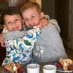 Two young friends having fun making dessert tacos together