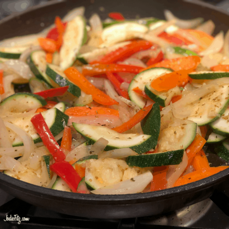 Pan of sautéed zucchini, carrots, onions and red bell peppers