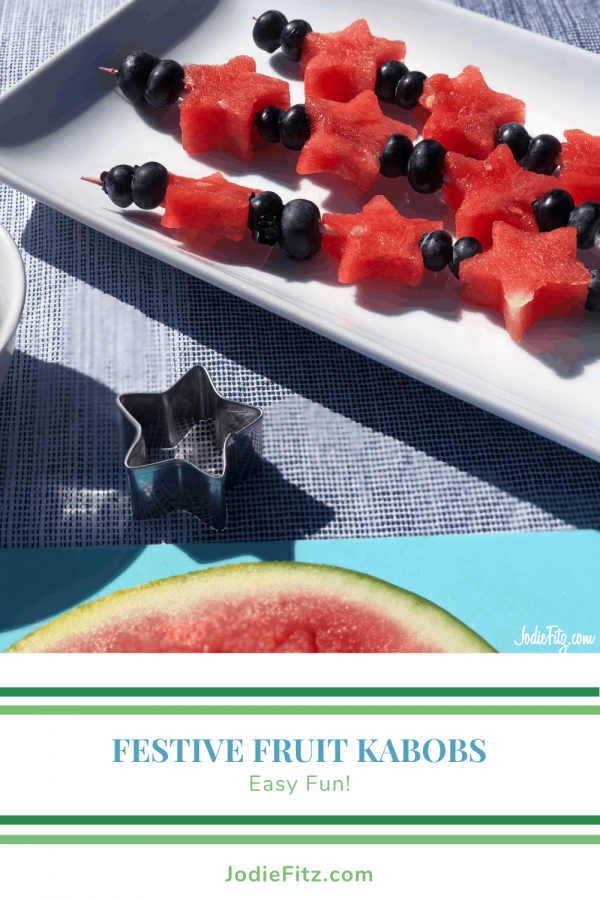 Plate with fruit kabobs made of heart shaped watermelon pieces and fresh blueberries