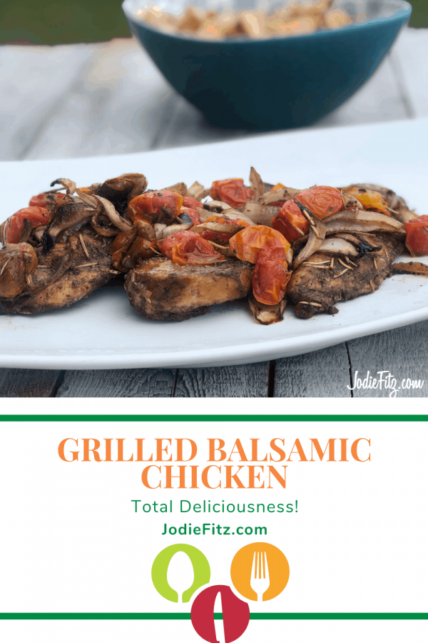 Grilled balsamic chicken topped with grilled grape tomatoes and sliced onions