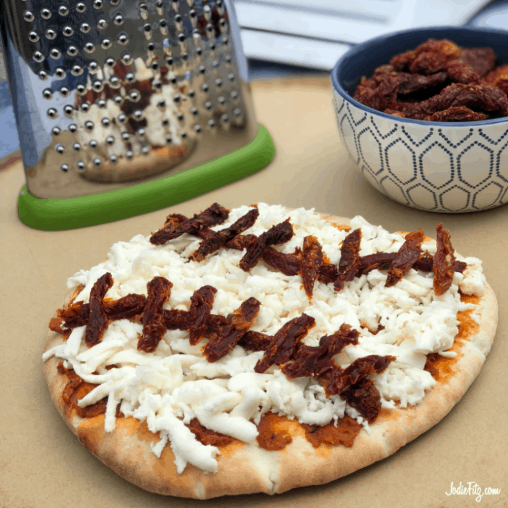 Pizza topped with sun-dried tomato strips to create a pizza that looks like a baseball